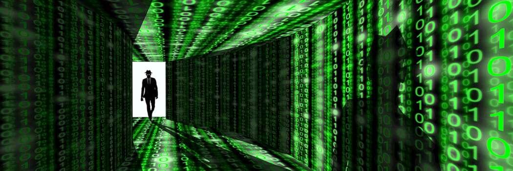 Cyber crime fighter walks down a matrix-like green hallway