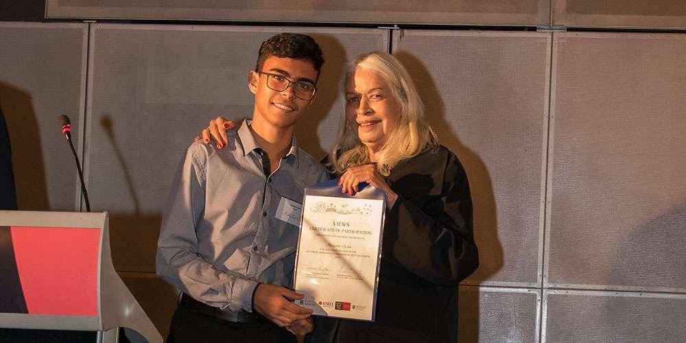 Ben Ogden receives his certificate of completion from Professor Langton Patron of the University of Melbourne VIEWS program