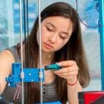 STEM skills - young girl is creating robotics